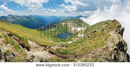 Lake Capra Of Romanian Fagaras Massif View From The Top. Beautiful Alpine Panorama Of Carpathians In
