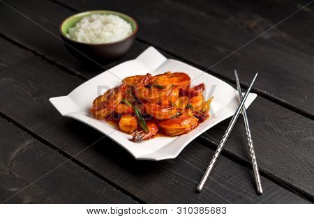 Ketchup Shrimp Plate On Dark Background. Ketchup Shrimp Plate With Bowl Of Rice And Chopsticks Angle