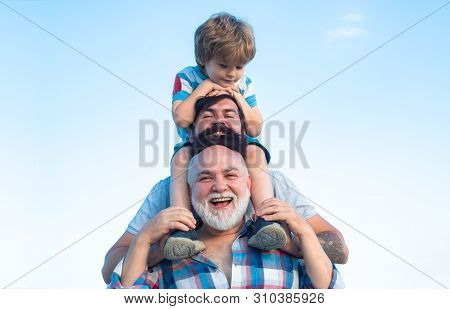Happy Man Family Have Fun Together. Fathers Day - Grandfather, Father And Son Are Hugging And Having