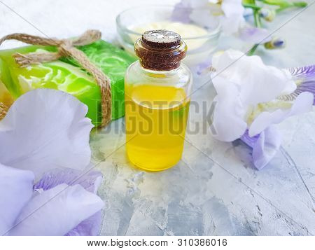 Cosmetic Oil, Soap Flower Iris On A Concrete Background