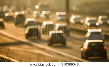 Heavy morning city traffic/congestion concept - cars going very slowly in a traffic jam during the morning rushhour - blurred photo