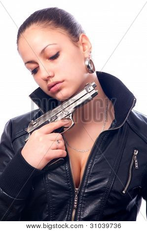 Beautiful girl in black leather jacket and beretta gun in her hands isolated on white background