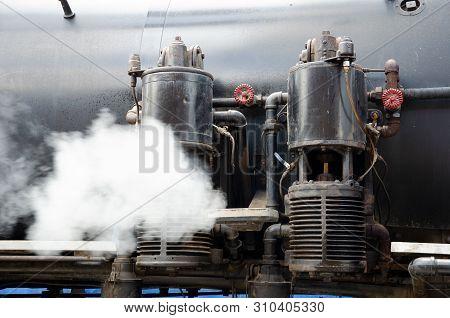 Valves On Steam Train.  Baldwin Steam Locomotive Close Up.  Running Antique Steam Engine.