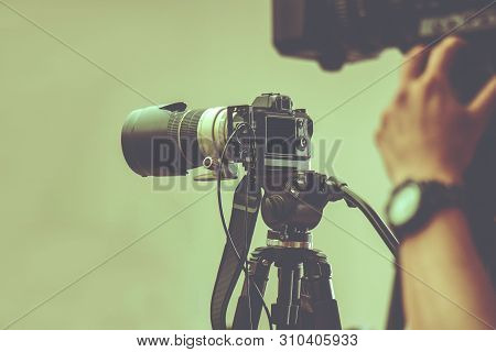 Professional Video Camera With Tripod Stand By For Shooting In Studio Production