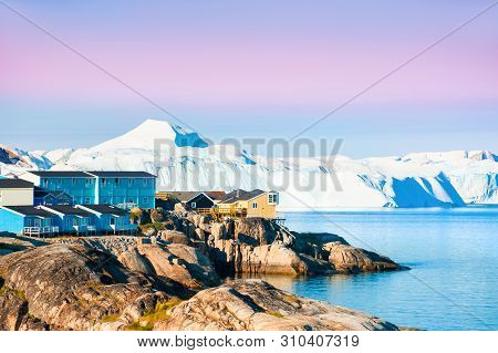 Shore Of Atlantic Ocean With Icebergs In Ilulissat Town At Sunrise, Western Greenland.