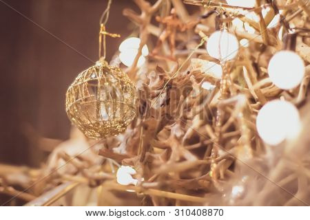 Light Bulb Decor In Party . Abstract Christmas Tree In Golden Ligh