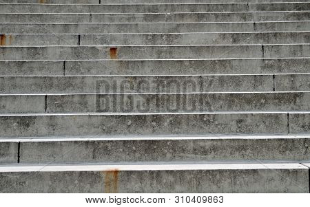Outdoor Staircase With Large Grungy Concrete Steps, Partly Rusty