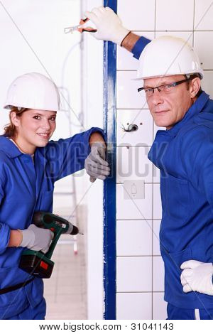 female and male electrician