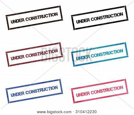 Under Construction Rectangular Stamp Collection. Textured Seals With Text Isolated On White Backgoun