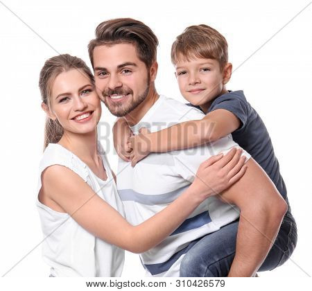 Portrait of couple with child on white background. Happy family