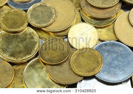 Old Golden And Silvery Coins . History Coins Texture Pattern Money Background. Top View