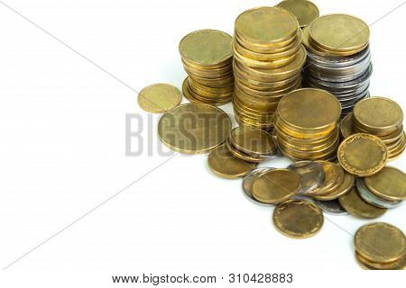 Gold Towers Made Out Of Gold And Silvery Coins, Stack Isolated On White.