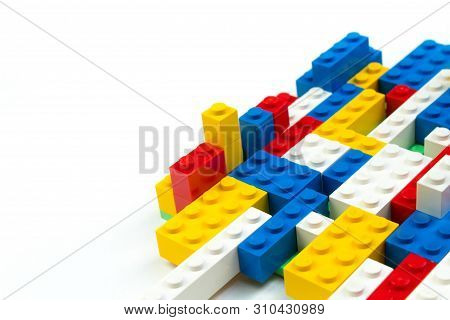 Lot Of Colorful Rainbow Toy Bricks . Educational Toy For Children Isolated On White Background. 3d R
