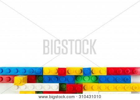 Wall From Plastic Building Blocks Isolated On White Background. Top View With Copy Space.