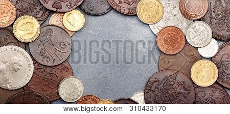 Numismatics. Old Collectible Coins Made Of Silver, Gold And Copper On A Table. Top View. Copy Space