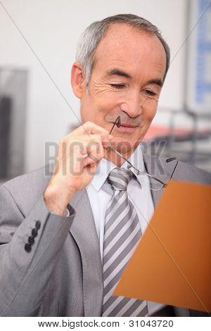 Senior businessman relaxing at desk