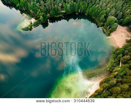 Aerial Top Down View Of Beautiful Green Waters Of Lake Gela. Birds Eye View Of Scenic Emerald Lake S