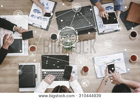 Multimedia And Computer Applications Concept. Business People Using Technology Of Digital Gadget Wit