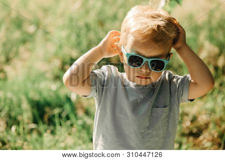 Cute Hipster Boy In Sunglasses In The Park. Weekend, Holidays, Summer Fun.