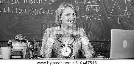 Always Happy. Teacher With Alarm Clock At Blackboard. Time. Woman In Classroom. Back To School. Teac