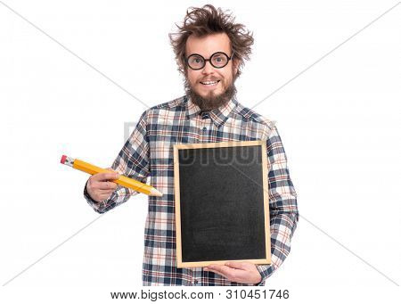 Crazy funny bearded man with tousled hair, scientist or professor in glasses with big pencil holding teacher blackboard, isolated on white background.