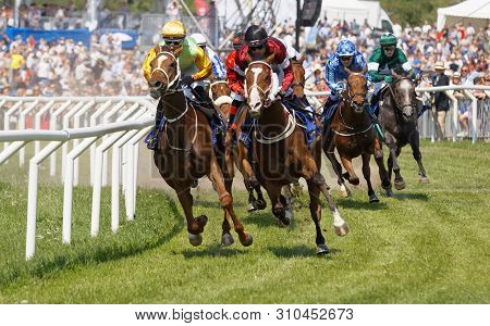 Stockholm, Sweden - June 06, 2019: Closeup Of Tough Fight Between Many Jockeys Riding Arabian Race H