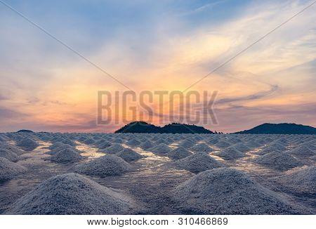 Salt Farm In The Morning With Sunrise Sky Over The Mountain. Organic Sea Salt. Evaporation And Cryst