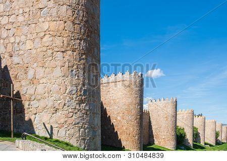 Walls surrounding Spanish city of Avila, turrets poster