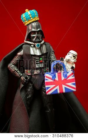 JULY 7 2019: Star Wars Sith Lord Darth Vader dressed as the queen of England, humor image - Hasbro action figure