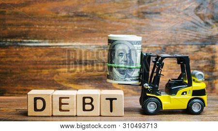 Wooden Blocks With The Word Debt, Dollars And Forklift. The Amount Of Money Borrowed Under Certain C