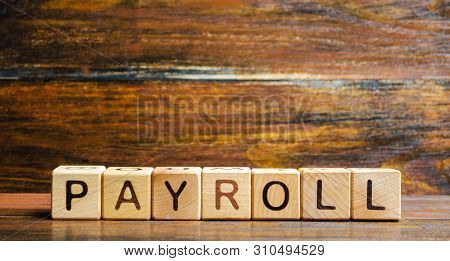 Wooden Blocks With The Word Payroll. Payroll Is The Sum Total Of All Compensation A Business Must Pa
