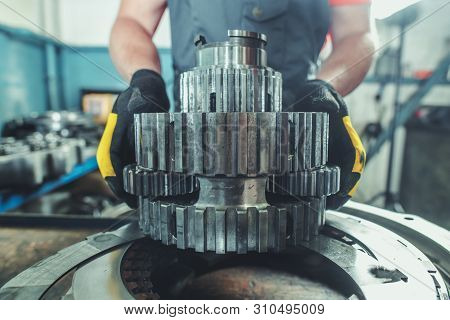 Planetary Gear Replacement By Caucasian Heavy Duty Machinery Technician. Industrial Theme. Complex R
