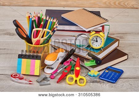 Stationery Supplies On Wooden Background. Workspace With Assorted School Or Office Items. Back To Sc