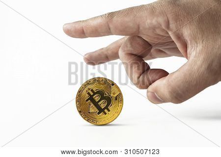 Man Put Bitcoin On Edge And Pulls It Away Kicking With Index Finger. Depreciation Of Virtual Money B