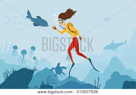 The Girl Diver Playing With A Dolphin. Scuba Diver. Underwater World. Girl Dive On A Coral Reef. Sum