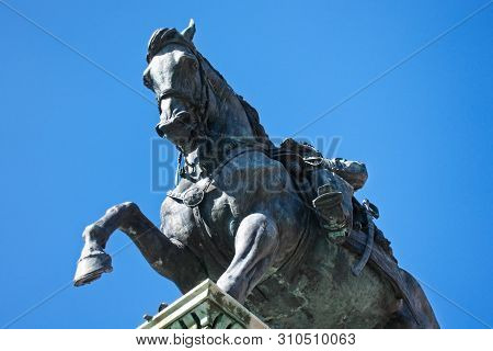 View From Below Of A Bronze Statue Of A Horse