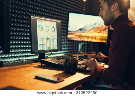 Confident Man Video Editor Works with Footage in Creative Office Studio. poster