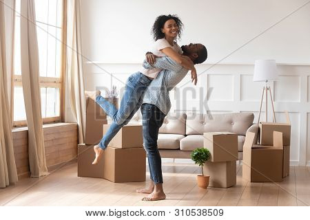 Happy African Couple First Time Home Buyers Celebrate Moving Day
