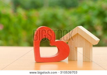 House With A Red Wooden Heart. House Of Lovers. Affordable Housing For Young Families, Support Progr