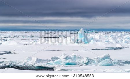 Pack ice at 80 degrees north, of the northern coast of Svalbard and in the Arctic circle.
