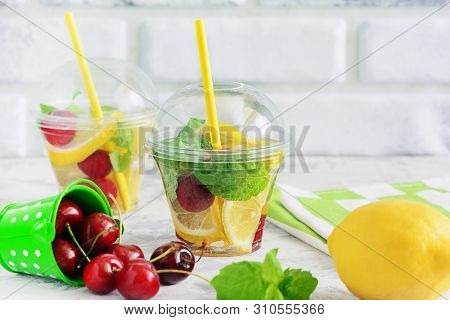 Detox Water Fruit Mix Infused Beverage With Mint. Nonalcoholic Vegan Drink With Fresh Lemon And Red