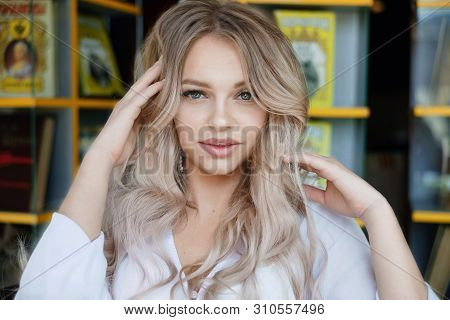 Beauty Smiling Happy Model With Natural Make Up And Long Eyelashes Smiles In Cafe.