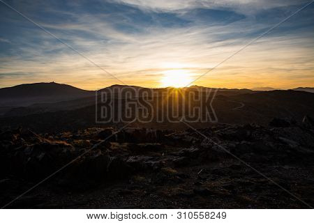 View of the sunset with golden and blue sky and mountains in Cap de Creus, Catalunya poster
