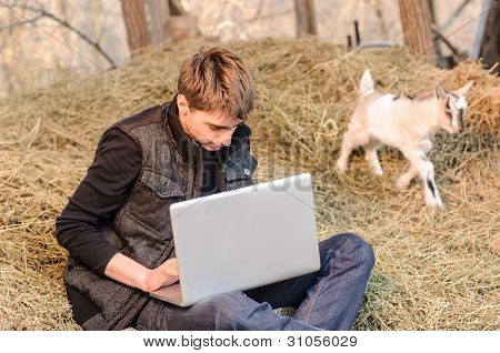 Laptop and a goat