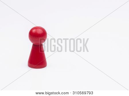 The Image Shows A Red, Wooden Figure Isolated On White