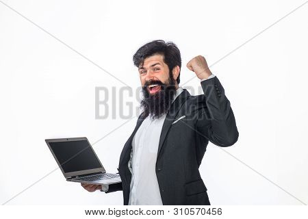 Smiling Man Working With Laptop Computer At Office. Office, Business, Technology, Internet. Business