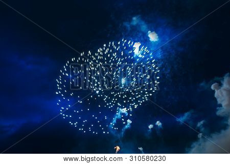 Inexpensive Fireworks, Over The City Sky, Green And Blue. For Any Purpose Use.