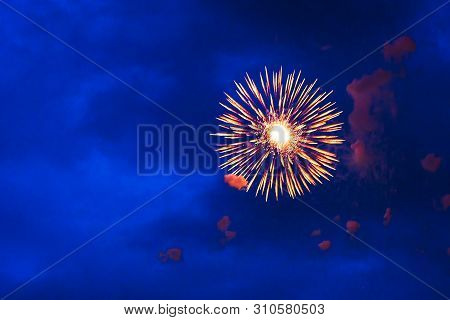 Inexpensive Fireworks, Over The City Sky, Red And Blue. For Any Purpose Use.