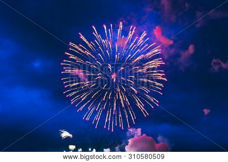 Inexpensive Fireworks, Over The City Sky, Yellow And Pink. For Any Purpose Use.