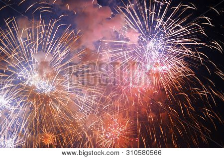 Inexpensive Fireworks, Over The City, Red, Blue And Pink. Bright And Shiny. Selective Focus. For Any